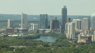 AF0001_000101 - HD stock footage aerial video of skyscrapers beside Lady Bird Lake in Downtown Austin, Texas