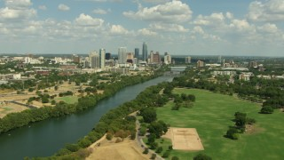 AF0001_000106 - HD stock footage aerial video fly over Austin City Limits Music Festival grounds to approach the lake and Downtown Austin, Texas
