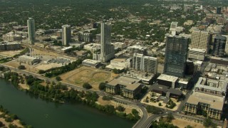 AF0001_000116 - HD stock footage aerial video of skyscrapers and power plant near Lady Bird Lake, Downtown Austin, Texas