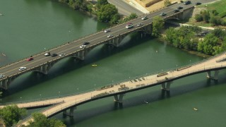 AF0001_000117 - HD stock footage aerial video of Lamar Boulevard Bridge and Pfluger Pedestrian Bridge over Lady Bird Lake, Downtown Austin, Texas