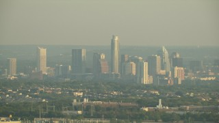AF0001_000125 - HD stock footage aerial video of the city skyline on a hazy day, Downtown Austin, Texas