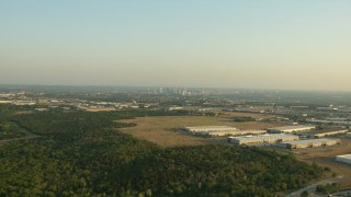 AF0001_000126 - HD stock footage aerial video flyby warehouse buildings to approach the skyline of Downtown Austin, Texas