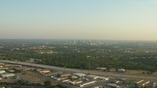 AF0001_000127 - HD stock footage aerial video approach the 71 freeway with a view of Downtown Austin, Texas