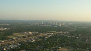 AF0001_000129 - HD stock footage aerial video of 290 freeway near high school, zoom on city skyline, Downtown Austin, Texas