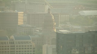 AF0001_000131 - HD stock footage aerial video tilt from Congress Avenue Bridge to reveal skyscrapers and Texas State Capitol, Downtown Austin, Texas