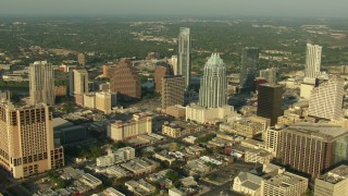 AF0001_000133 - HD stock footage aerial video flyby skyscrapers to reveal small bridges spanning Lady Bird Lake in Downtown Austin, Texas