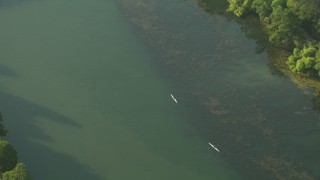 AF0001_000138 - HD stock footage aerial video of a bird's eye view of kayakers and bridges spanning Lady Bird Lake, Downtown Austin, Texas