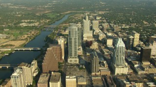 AF0001_000141 - HD stock footage aerial video of skyscrapers by bridges over Lady Bird Lake in Downtown Austin, Texas