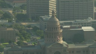AF0001_000151 - HD stock footage aerial video approach the Texas State Capitol dome in Downtown Austin, Texas