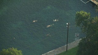 AF0001_000154 - HD stock footage aerial video of reverse view of people swimming in a canal, Austin, Texas