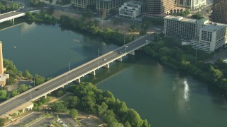 AF0001_000155 - HD stock footage aerial video of light traffic on Congress Avenue Bridge spanning Lady Bird Lake in Downtown Austin, Texas