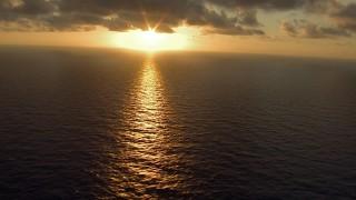AF0001_000163 - HD stock footage aerial video tilt from a reflection of sunlight on Galveston Bay, Texas, to reveal the sunrise