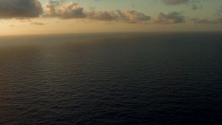 AF0001_000164 - HD stock footage aerial video of clouds over Galveston Bay, Texas, at sunrise