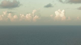 AF0001_000165 - HD stock footage aerial video of flying by sunlit clouds over the bay, Galveston Bay, Texas, sunrise