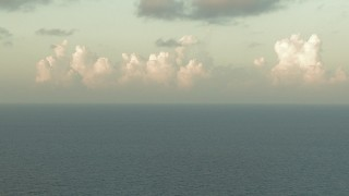 AF0001_000166 - HD stock footage aerial video of sunlit clouds over Galveston Bay, Texas, at sunrise