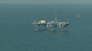 AF0001_000167 - Aerial stock footage of A large oil platform in the Gulf of Mexico