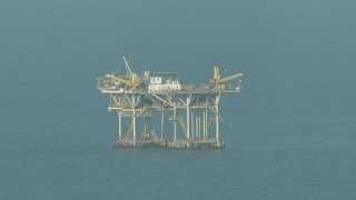 AF0001_000168 - HD stock footage aerial video of flying by an oil platform in the Gulf of Mexico
