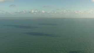 AF0001_000169 - HD stock footage aerial video fly over the Gulf of Mexico to approach the Matagorda Peninsula, Texas