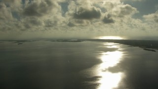 AF0001_000174 - Aerial stock footage of Clouds over Matagorda Bay beside the peninsula, Texas