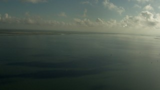 AF0001_000175 - Aerial stock footage of A view across Matagorda Bay, Texas, with clouds overhead