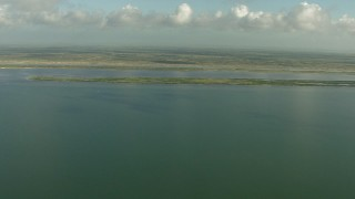 AF0001_000176 - Aerial stock footage of Pan across the coast while flying over Matagorda Bay, Texas