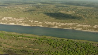 AF0001_000177 - Aerial stock footage of Flying over the grassy shore of Matagorda Bay, Texas