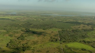 AF0001_000179 - Aerial stock footage of Fly over marshland in Matagorda County, Texas