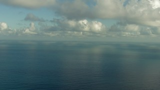 AF0001_000186 - HD stock footage aerial video fly over the Gulf of Mexico and beneath clouds, and pan across the water