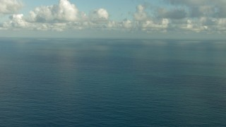 AF0001_000187 - HD stock footage aerial video flyby open sea beneath low clouds in the Gulf of Mexico