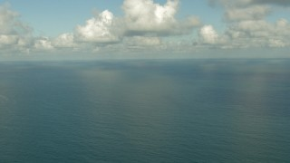 AF0001_000189 - HD stock footage aerial video flyby the open sea in the Gulf of Mexico with clouds overhead