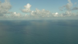 AF0001_000190 - HD stock footage aerial video of passing the open water of the Gulf of Mexico with clouds overhead