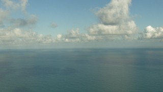 AF0001_000191 - Aerial stock footage of Gulf of Mexico beneath the clouds