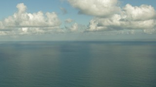 AF0001_000192 - Aerial stock footage of A view of the Gulf of Mexico beneath the clouds