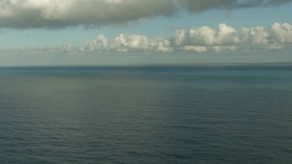 AF0001_000194 - HD stock footage aerial video pan across the water and descend low over the Gulf of Mexico, with the Matagorda Peninsula in the background, Texas
