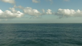 AF0001_000195 - Aerial stock footage of Fly low of the Gulf of Mexico to approach the Texas coast, Matagorda Peninsula, Texas