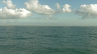 AF0001_000196 - HD stock footage aerial video fly low over the Gulf of Mexico and approach the coast, Matagorda Peninsula, Texas