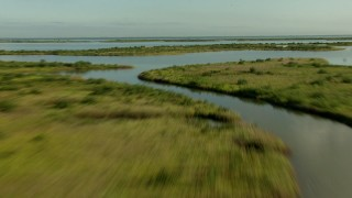 AF0001_000199 - HD stock footage aerial video of flying low over marsh and wetland on the Matagorda Peninsula, Texas