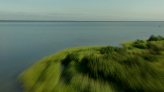 AF0001_000200 - Aerial stock footage of Flying low over marshland and Matagorda Bay, Texas