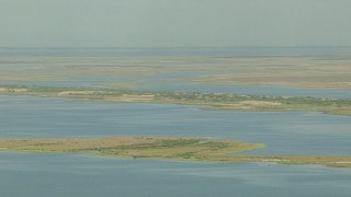 AF0001_000202 - Aerial stock footage of Flying by wetlands on Matagorda Bay, Texas