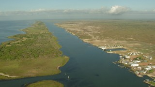 AF0001_000203 - Aerial stock footage of Passing waterfront homes with docks on Matagorda Bay, Matagorda Country, Texas