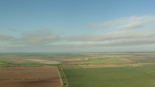 AF0001_000210 - Aerial stock footage of A view across farm fields in Matagorda County, Texas