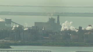 AF0001_000216 - Aerial stock footage of Alcoa Aluminum Plant next to Lavorna Bay, Point Comfort, Texas