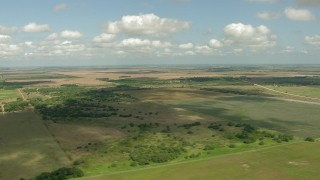 AF0001_000221 - HD stock footage aerial video of passing by farms and fields in Wharton County, Texas