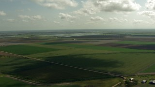 AF0001_000224 - HD stock footage aerial video of flying over farmland to approach fish farms, Danevang, Texas