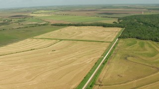 AF0001_000229 - HD stock footage aerial video of passing farm fields in Wharton County, Texas
