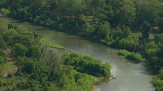 AF0001_000230 - HD stock footage aerial video of a bend in a river through the countryside in Wharton County, Texas