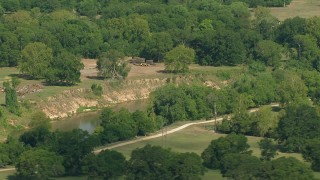 AF0001_000231 - HD stock footage aerial video flyby a river through the countryside in Wharton County, Texas