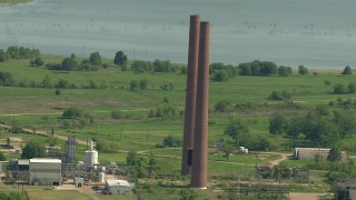 AF0001_000233 - HD stock footage aerial video of smoke stacks at the Wharton County Generation power plant in Newgulf, Texas