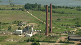AF0001_000234 - HD stock footage aerial video orbit the smoke stacks at the Wharton County Generation power plant in Newgulf, Texas