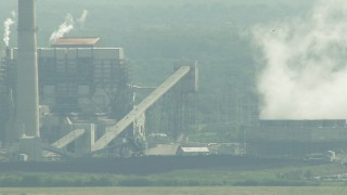 AF0001_000237 - Aerial stock footage of Structures at the WA Parish Generating Station by Smithers Lake, Texas
